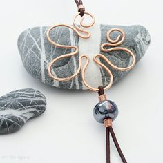 A copper flower pendant