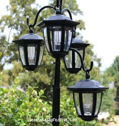 easy diy solar lights lamp post with flower planter, go green, landscape, lighting, outdoor living, I used cable ties to make the lamps varying lengths