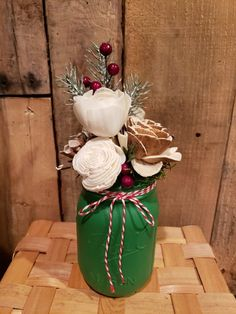 Christmas mason jar filled with wood flowers, greenery, pics, etc.  Perfect for the holiday mantle, table, etc.  Rustic, farmhouse, shabby.