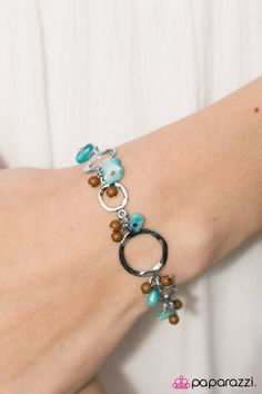 Paparazzi Accessories: Gulf Shores - Multi   Bits of blue rock and dainty wooden beads fall between hammered silver discs, creating a beachy fringe around the wrist. Features an adjustable clasp closure.  Sold as one individual bracelet.           Only   $5.  www.5sher.com  if it isn't there, then it sold out so be quick.