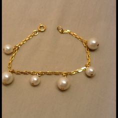 Bracelet gold color chain w/ hanging Pearl beads Bracelet with gold color chain and has dangling Pearl looking beads. These beads are different sizes. When flat it is 6 3/4 inches long. Super cute. (See other items I have a matching pair of earrings) no box. Open stock .never used. Accessories