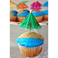 Different version of our Paradise Pops. Cupcakes with blue waves and graham cracker sand. Super delicious and cute! #ordertoday #beach #cupcakes #umbrella #brownsugar #sand #waves #ocean #beach #paradise