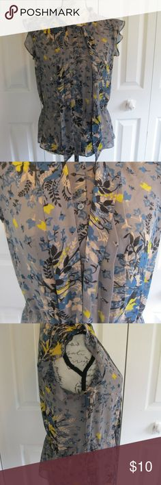 "Ann Taylor Loft Women's Blouse Size Medium Ann Taylor Loft Women's Blouse Size Medium.  Sheer look...100% polyester.  Cap sleeves...button down...tie in front on collar.  Floral leaves print.  Elastic waist.  Length measures 24"".  Bust measures 20"".  In great condition. LOFT Tops Blouses"