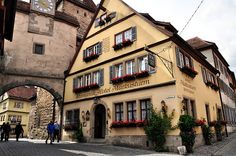 The charming Romantik Hotel Markusturm, at Rödergasse 1 in Rothenburg ob der Tauber, Germany, is located in a former toll house next to the Markus Tower and Röder Arch.
