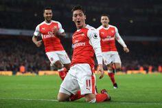Mesut Ozil celebrates scorin