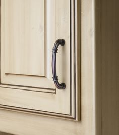 Lafayette cabinet pull from Jeffrey Alexander by Hardware Resources. (317-96DBAC shown in use)