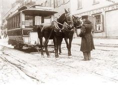 A horse drawn street car. The conductor is feeding the horses. New York City, 1908.