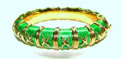 The Schlumberger enamel #bangle is one of Tiffany & Co's most #iconic pieces. We're fortunate here at CIRCA to buy these on a fairly regular basis, including this exquisite green enamel and 18kt gold version. These bangles were designed by Jean #Schlumberger, a #French #jewelry designer who is one of only four designers that Tiffany & Co. has allowed to sign their work. #TiffanyCo