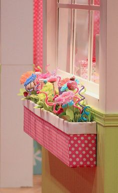 """INDOOR window box for girls room, too cute...The simplest way I to make this is..purchase a simple plastic window flower box from your local garden supply store. Cover the front, bottom and side with fabric (a hot glue gun ). Colour choices, flowers etc are yours. Add a """" brick """" of floral or styrofoam so that flowers etc can be pushed into it. It should be light weight and easy to hang."""