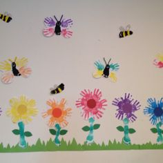 Spring art bulletin board with handprint flowers and butterflies. Would be fun for an ongoing canvas project.