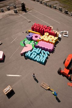 Poster for Malmö festival, plywood letters were created and photographed 30 m from above. By Snask