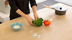 >>> IKEA Concept Kitchen 2025 // a team of students have created a concept kitchen table for Ikea, which acts as an integrated cooking hob and dining table and can suggest recipes based on ingredients you put on it