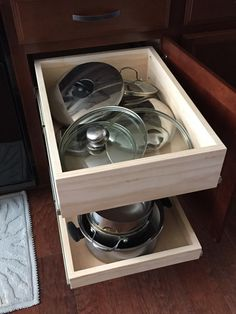 Added some pull out drawers to some of our base cabinets. A shallow drawer at the bottom for large items and pans and deeper drawers at the top storing pan lid… Diy Drawers, Pull Out Drawers, Cabinet Drawers, White Kitchen Cupboards, Diy Kitchen Cabinets, Kitchen Appliances, Diy Wood Projects, Home Projects, Soft Close Drawer Slides