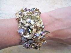 Great assemblage of vintage pins.  Statement cuff by layersoflace on Etsy