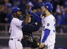Kansas City Royals Lorenzo Cain, left, celebrates with Eric Hosmer after Game 6 of baseball's World Series against the San Francisco Giants Tuesday, Oct. 28, 2014, in Kansas City, Mo. The Royals defeated the Giants 10-0 to tie the series at 3-3. (AP Photo/Charlie Neibergall)