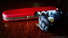 A single strand button knot, #647 in ABoK, as part of a paracord pocket knife fob.