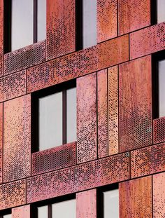 325 Kent by SHoP Architects The building's lower portion is clad with rusty-coloured copper panels, while upper floors are wrapped in zinc. Perforations in the curtain walls create subtle patterns across the facades.