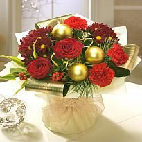 Vintage Christmas - One of our most elegant festive aqua pack bouquets, with a stunning mix of red Roses, red Carnations, Spray Carnations, entwined perfectly with Greenery and finished off with Gold Baubles.
