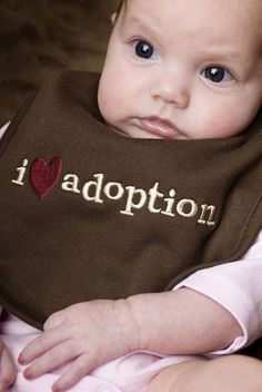 Lovely unisex I love #Adoption bib in chocolate brown. Perfect baby gift for anyone with a new baby who has been touched by adoption.