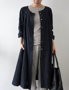 The stripes with the muted colors and finished with a long and light shirt/coat is a nice look for a cool summer day or night.