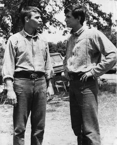 In a photograph published June 16, 1963, 'The Fool Killer' star Anthony Perkins, right, talks to his stand-in, University of Tennessee student Larry McMahon, during a break in filming in Townsend. The News-Sentinel reported that McMahon was chosen for his dramatic experience, athletic abilities, and similar build to that of Perkins.