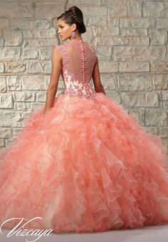 Quinceanera Gowns Style 89029: Contrasting Lace Appliques on Ruffled Tulle with Beading.  http://www.morilee.com/quinceanera/quinceaneravizcaya/89029