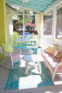 House of Turquoise: Cottage on the Green - Tybee Island  Mix of fabrics on wicker seating
