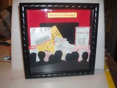 Ticket Shadow Box.  The seats with people cut-out, brilliant!