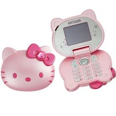 An actual Hello Kitty™ Cellphone! I think Apple© & Sanrio© should get together & make a Hello Kitty iPhone! ~AF.