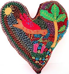 Hand embroidred heart cushion created by a women's sewing group in Cape Town South Africa.
