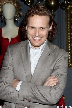 Sam Heughan Talks About His 'Outlander' Modesty Pouch & Losing His Virginity: Photo Sam Heughan and Caitriona Balfe pose for photos while attending the unveiling of Outlander's special window display at Saks Fifth Avenue on Thursday (April in… Sam Heughan Actor, Sam Heughan Outlander, Diana Gabaldon Outlander Series, Outlander Tv Series, Sam Hueghan, Sam And Cait, Jaime Fraser, Outlander Season 2, Scottish Actors