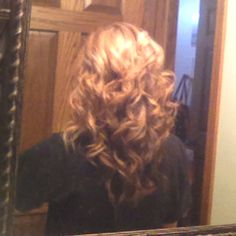 Hair curled with flat iron :)
