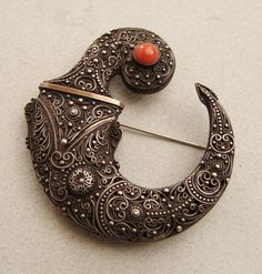 Africa | Silver and coral brooch from Morocco or Tunisia | Early 20th century | Item is on hold.