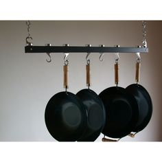 Features:  -Modern style.  -Track Rack collection.  -Material: Wood.  -Finish compliments all cookware.  -Wood and cast aluminum construction.  -Mounting hardware included.  Material: -Wood. Dimension