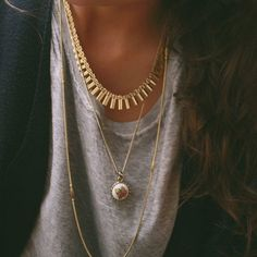 Layered gold necklaces.