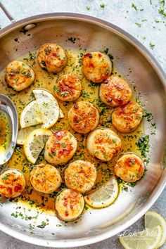 Lemon Garlic Butter Scallops on your table in less than 10 minutes, coated in a deliciously silky lemon garlic butter sauce! Cheaper than going out to a restaurant and just as good as chef made scallops! They are the ultimate treat!   cafedelites.com