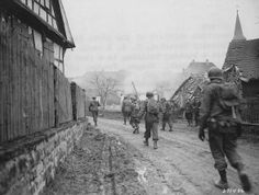 180th Regiment of the 45th Infantry Division enters Wingen. December 1944
