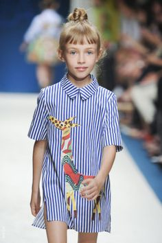 It is very loose fitting and the designer applied cartoon characters on the shirt to create cuteness.