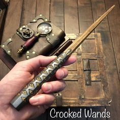This listing is for a custom made wand commissioned by Lance. The wand chooses the wizard and if you are not Lance, this wand didnt choose you! This handsome wand is 12 1/2 long and made of Hazel wood sourced from Pennsylvania. The wand is inspired by Gimli's axes from LOTR features