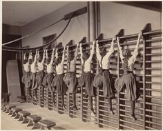 "indypendent-thinking: "" Charlestown High School (girls exercising on bars against the wall), 1899 (by Boston Public Library) """