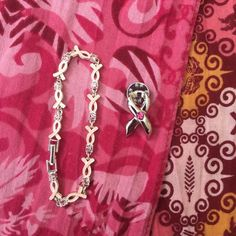 Breast Cancer Ribbon Bracelet & Pin Breast Cancer Awareness bracelet and pin with free warrior scarves. Bundle with other items in my closet for a discount!! Jewelry Bracelets