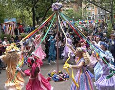 Dancing round the May pole.