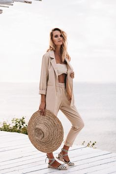 The Argile Blazer is a perfect luxe staple that can be worn in any season. Made from a sandy-beige linen fabric, this blazer features a structured lapel, twin pockets at the front, long sleeves and a small split at the back. Pair with the Argile Trousers for a perfect matching set! By SABO LUXE