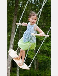 Have you ever seen a swing like this! I'm thinking this could be made with an old skateboard and some rope