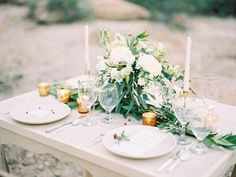I love the greenery on the table as opposed to a traditional floral runner!