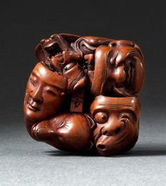 "WOOD NETSUKE 19th Century By Masakata. Depicting eleven theatrical masks. Signed. Length 1.5""."
