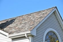 Shingles can get really hot in the summer. Of course metal can too. I think the metal is more slick though. Bill | http://www.roofingcontractorpittsburgh.com