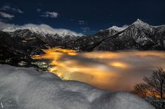 In this beautiful night-time capture by Jacopo Martocchi, we see fog illuminated by the city lights of Chiavenna, Italy. The artificial light gives the fog a 'lava-like' quality.