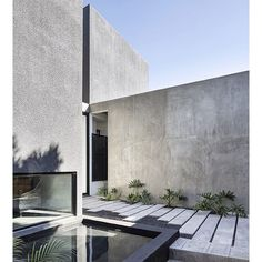"""""""the courtyard of a residence in mexico designed by @T38studio combines different volumes in black and gray concrete, shaped as trapezoidal prisms to respond to its irregular plot shape.  read more over on #designboom! #architecture #designboomreaders"""" Photo taken by @designboom on Instagram, pinned via the InstaPin iOS App! http://www.instapinapp.com (01/07/2016)"""