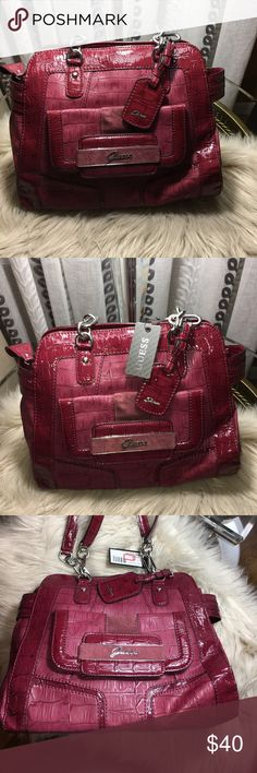 "NEVER USED GUESS THAYER SWAGGER SATCHEL Ruby Colored Crocodile-printed vinyl exterior with patent and suede trim. Silver-tone hardware. • Script logo at front. Zipper closure. • Interior and exterior pockets • Two handles • 8""W x 7 ½""H x 4""D Guess Bags Satchels"